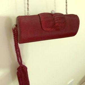 Burgundy purse w/ long silver chain & bling design